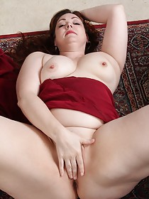 Chubby redheaded MILF showing off her pussy up close, on the floor